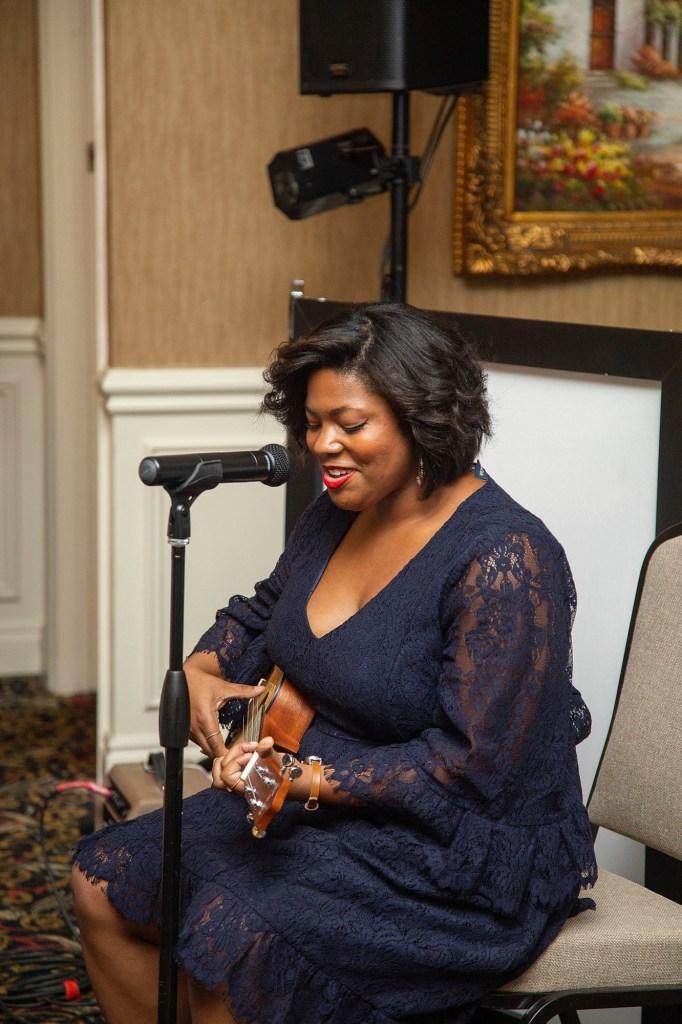 Taylor Boykins singing at Novi wedding