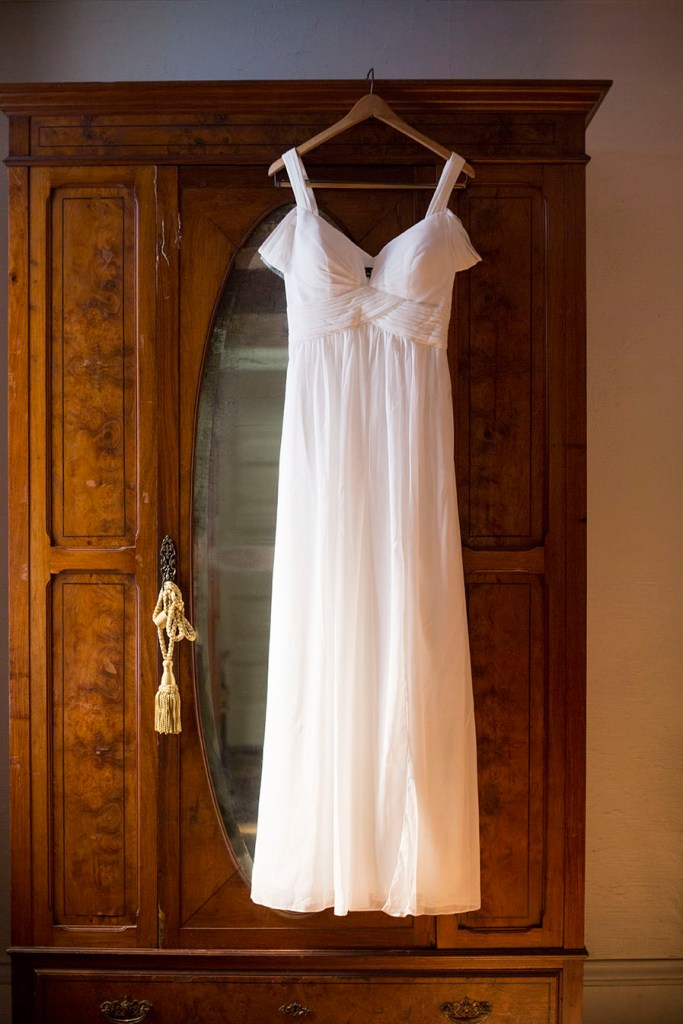 Wedding dress hangs on a wardrobe at Celebrations Wedding Chapel
