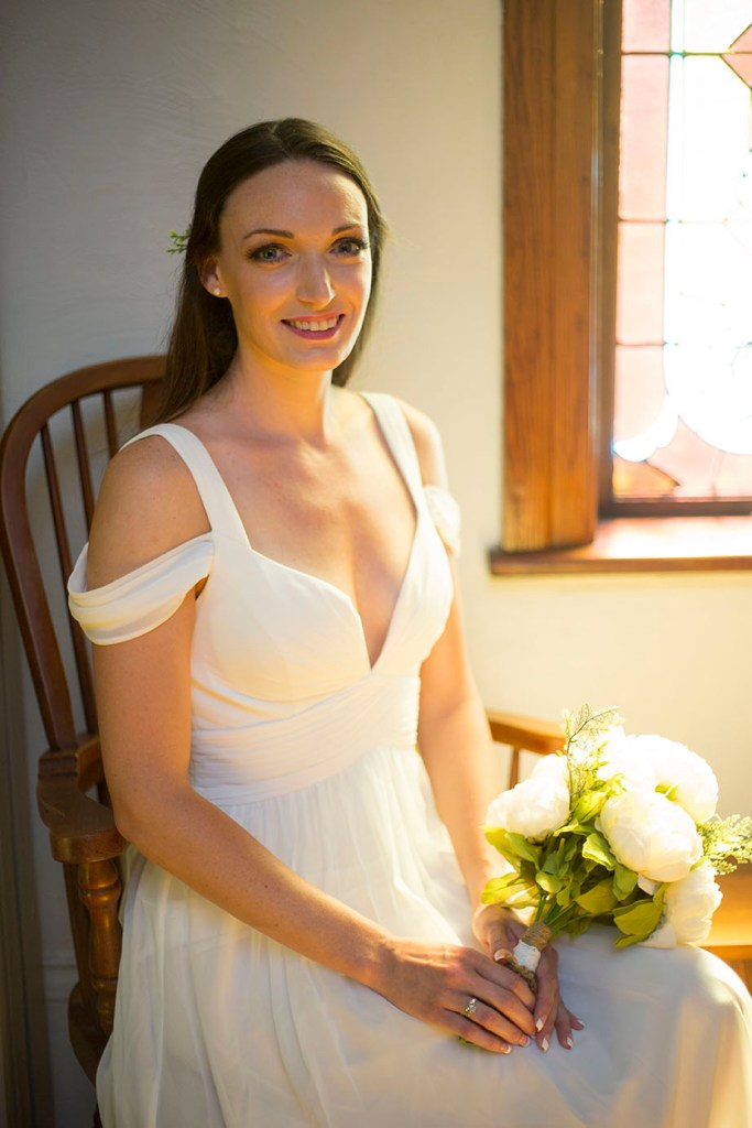 Bride sitting in a rocking chair at Celebrations Wedding Chapel