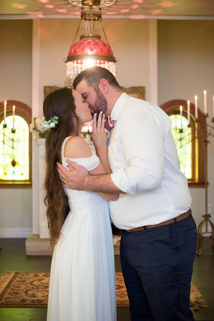 First kiss at Celebrations Wedding Chapel in Horton Michigan