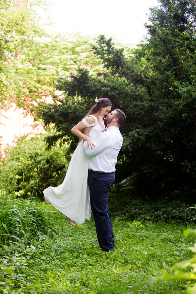 Groom lifts bride into the air
