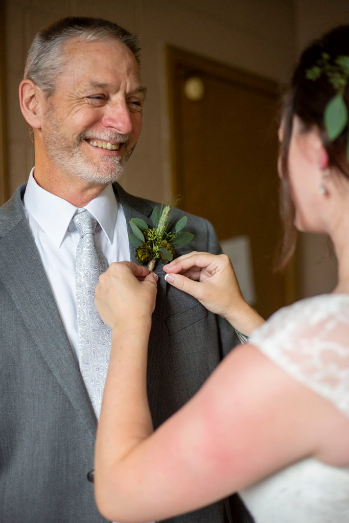 Rachel pins on her father's boutonniere