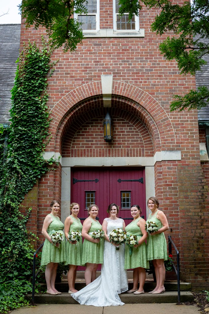 Bridesmaids outside of the church