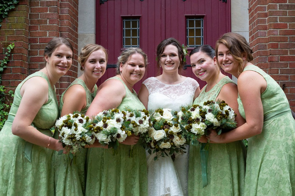 Bridesmaids outside of Lutheran church in Northville