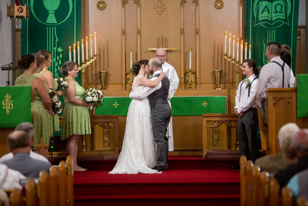 First kiss at their Northville wedding