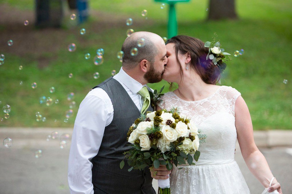 Wedding couple surrounded by bubbles