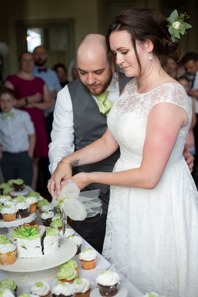 Cutting the cake at their Chelsea wedding