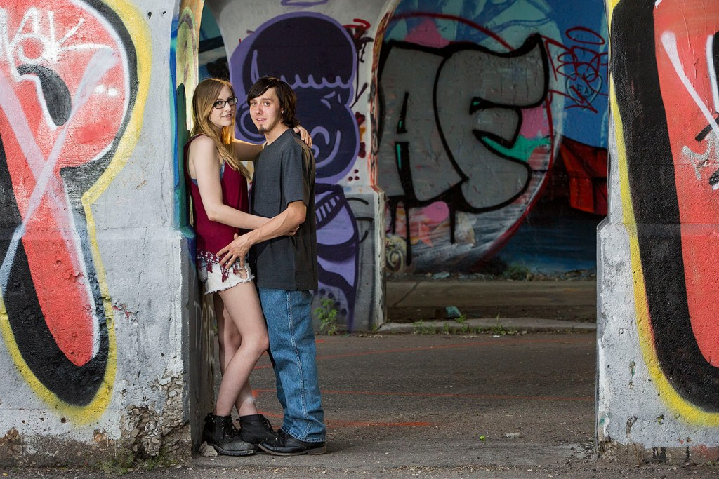 Couple poses in overpass