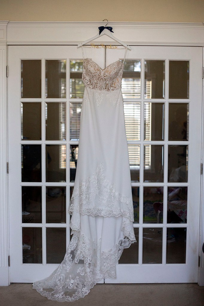 Bride's dress in front of French doors