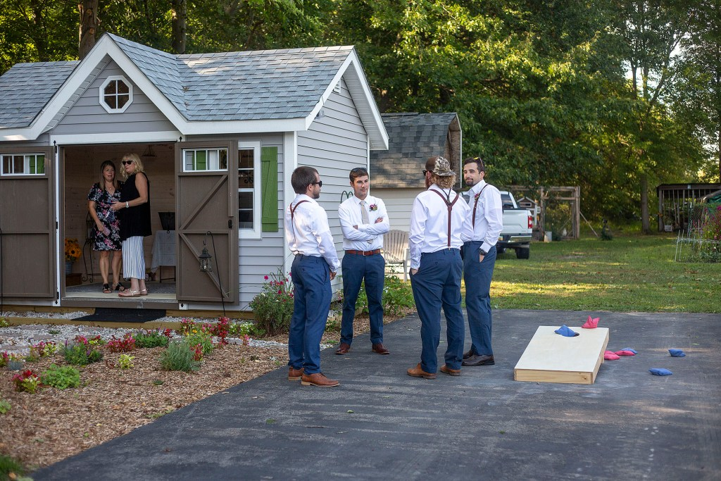 Groomsmen hanging out before the Belleville wedding
