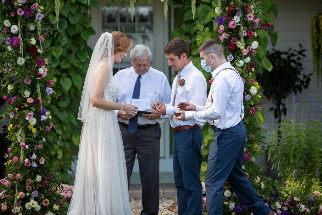 Exchanging of wedding rings at Belleville wedding