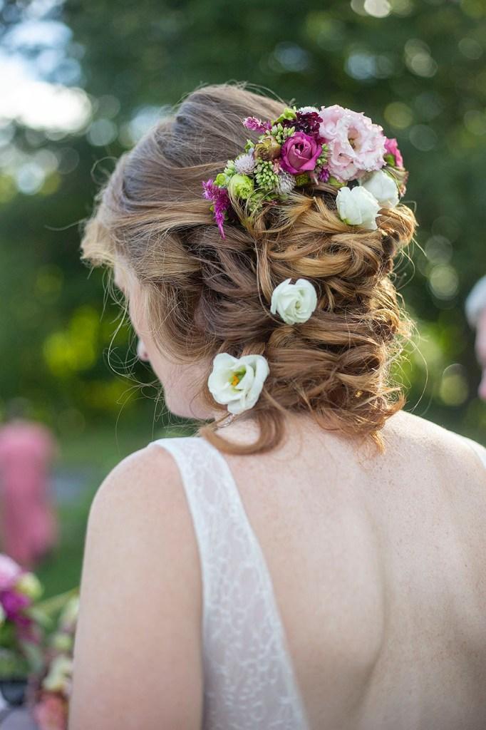 Carmen's floral hairpiece