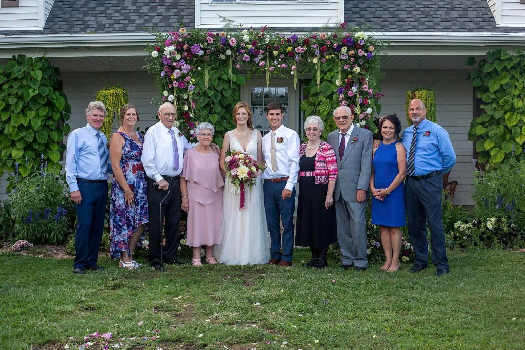 Bride and groom's side for family photos