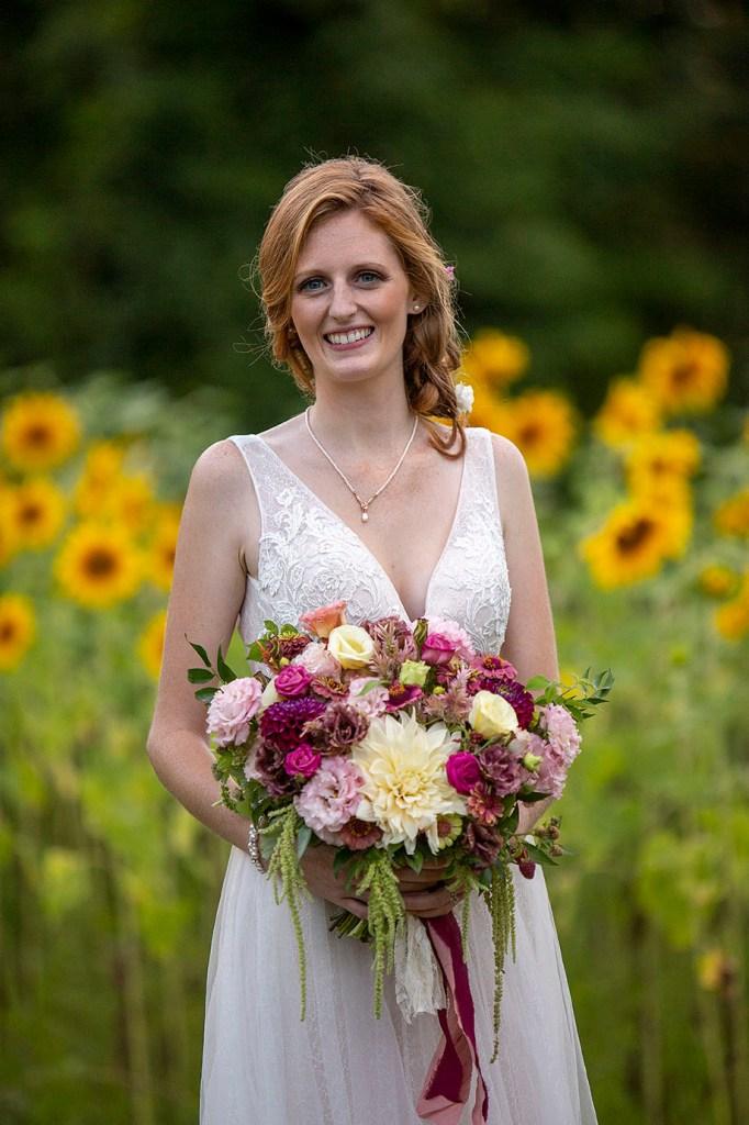 Stunning Carmen standing in front of the sunflower fields