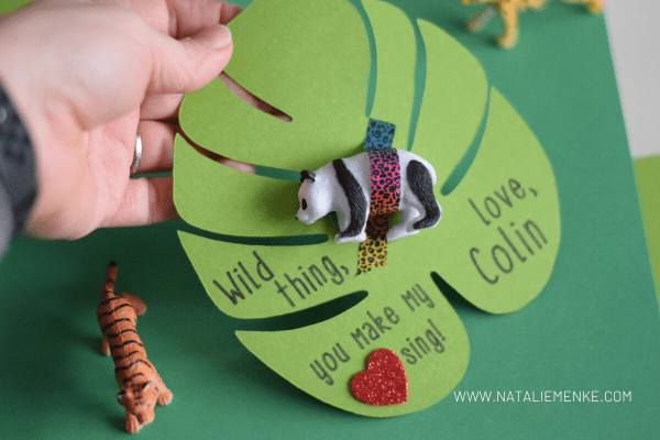 """hand holding a """"Wild Thing"""" Valentine with panda bear and washi tape"""