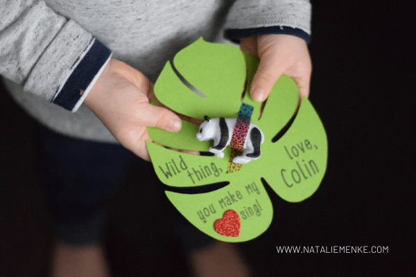 """child's hands holding a """"Wild Thing"""" Valentine with panda bear and washi tape"""