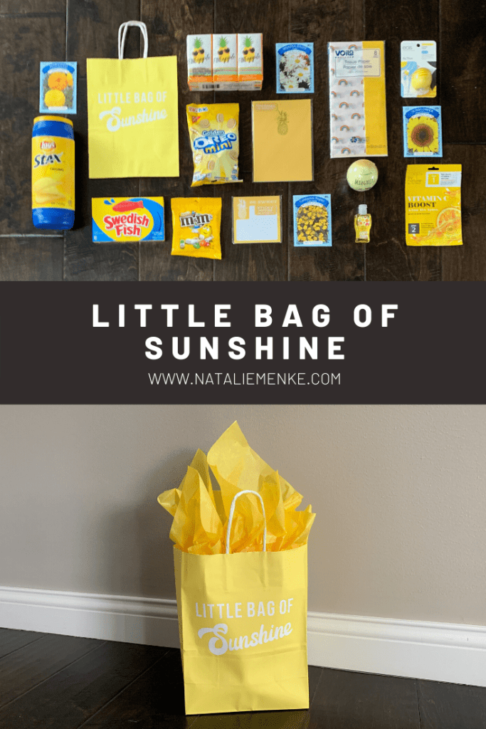 "yellow gift bag with the words ""Little Bag of Sunshine"" and yellow tissue paper"