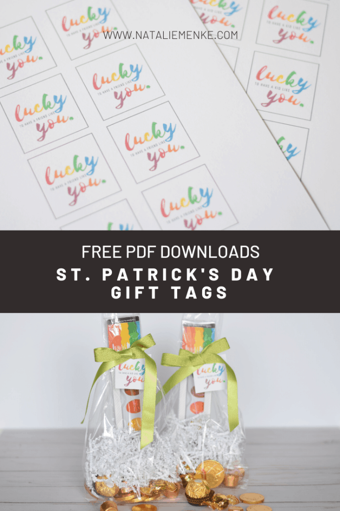 sheets of 'lucky to have a friend like you' rainbow gift tags and watercolor treat bags with gold wrapped candy