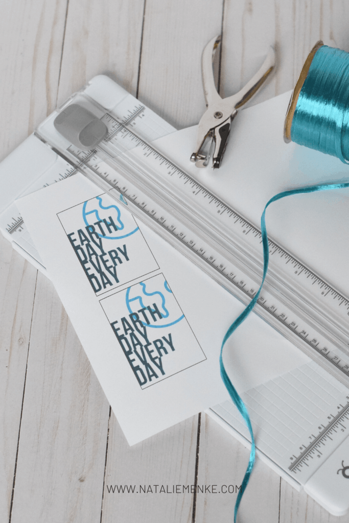 """Earth Day Every Day"" gift tag with paper cutter, ribbon and hole punch"
