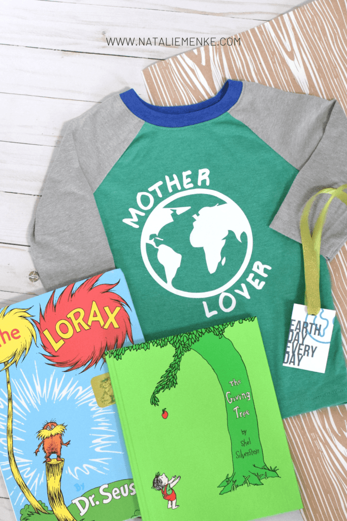 """Earth Day shirt with the words """"mother lover"""" and a earth symbol, """"The Lorax"""" and """"The Giving Tree"""" books and a gift tag"""