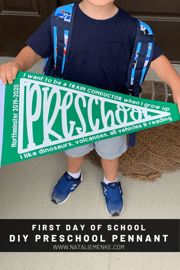 boy holding first day of school sign