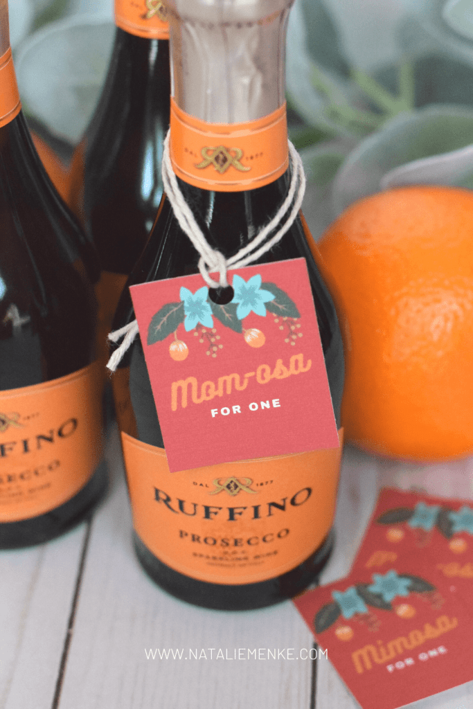 prosecco, orange juice and orange with mimosa gift tag