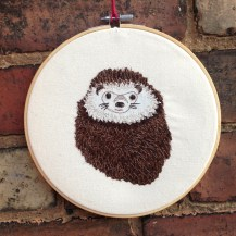 textile art, hedgehog, spots, brown, embroidery, wall hanging