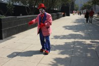 Although clowning may have gone out of fashion in many parts of the world, not here. It's not uncommon to see clowns performing around the streets of Mexico City. They often do tricks at traffic lights or on public buses. During a mini-parade around central Mexico City, some of the clowns broke off to walk around and chat with members of the public