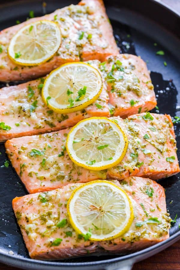 Oven Baked Salmon garnished with lemon slices and parsley