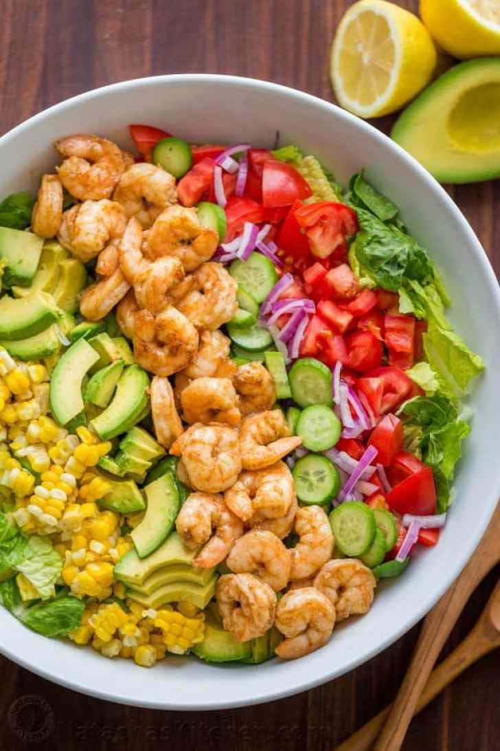 Shrimp Cobb Salad with a chopped romaine base layered with cajun shrimp, avocado, and tomatoes