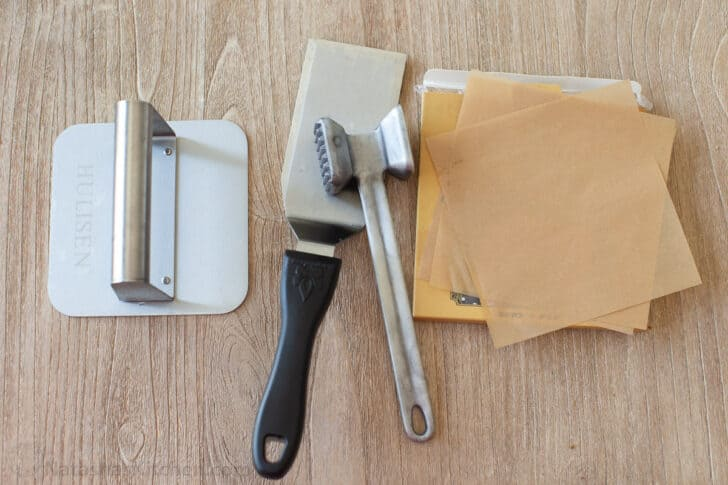 Smash burger press, spatula and parchment paper