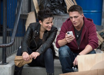 "Arrow -- ""Broken Dolls"" -- Image AR203b _0467b_BTS -- Pictured (L-R): Bex Tayor-Klaus as Sin and Colton Haynes as Roy Harper -- Photo: Cate Cameron/The CW -- © 2013 The CW Network, LLC. All Rights Reserved"