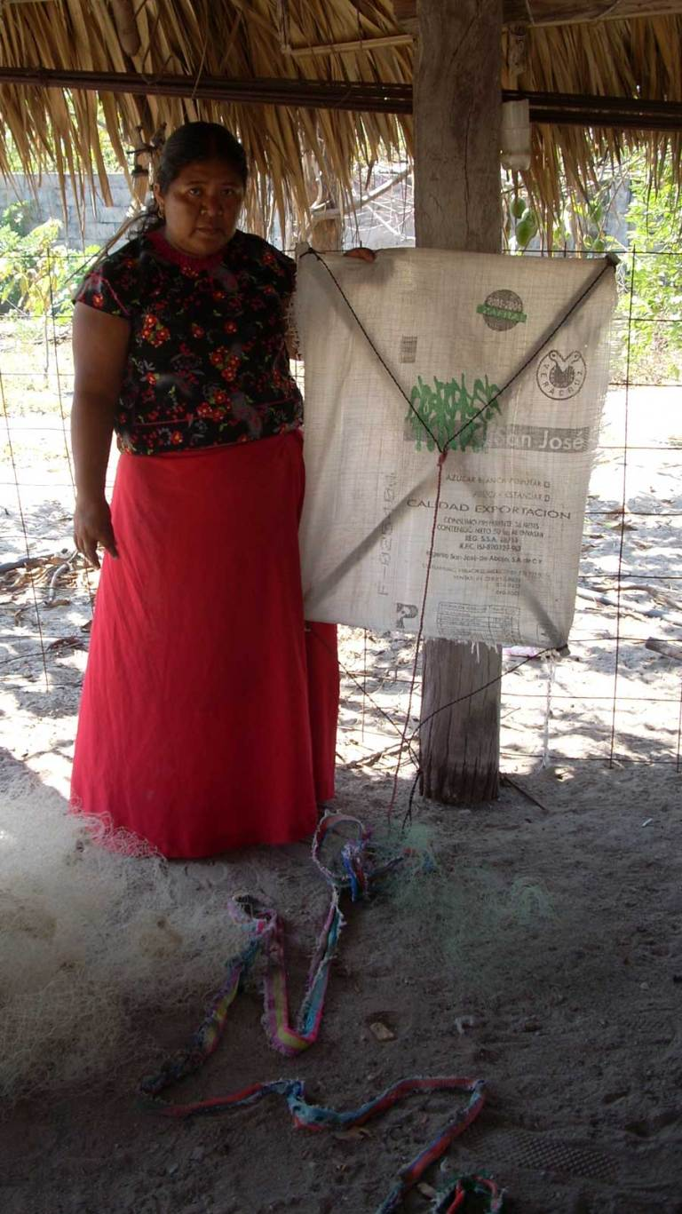 A villager stands alongside a fishing kite and nets. Using kites to fish during a Tehuano is a way of life for the people of San Mateo and Santa Maria del Mar in the Isthmus of Tehuantepec, Mexico. (Courtesy C. Ornelas)