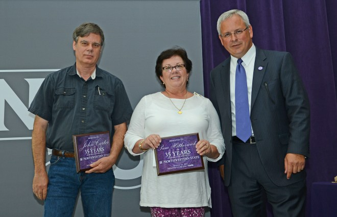 John Carter and Pam Hetherwick were recognized for 35  years of service to Northwestern State University.  Carter is property manager for Facilities Services and Hetherwick is administrative assistant for University Affairs.  Not shown is Ladell Conlay, administrative assistant for the School of Creative and Performing Arts. Dr. Jim Henderson, university president, presented the awards during NSU's annual faculty/staff lunch