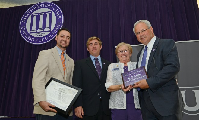 Northwestern State University recognized Maxine Johnson with a certificate and other gifts for 50 years of service to the University. The university will light the columns purple to honor Johnson, who is the director of planning, grants and development in the College of Nursing and School of Allied Health.