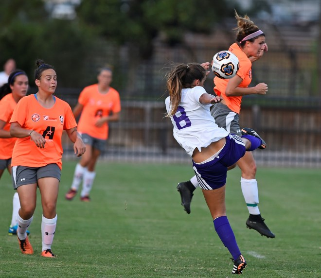 PHOTO CUTLINE: NSU junior defender Patry Carrion (8) clears a ball in the season-opener against LSU-Alexandria on Aug. 21. PHOTO: Gary Hardamon