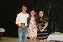 Kelsey Shoemaker presented retiring chapter officer plaques to Vice President Tyler Sullivan and President Emily Johnson.