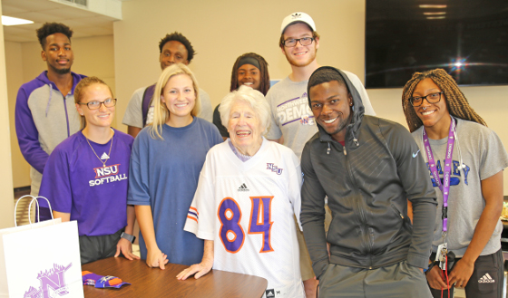 Leola Loftin with Athletes.JPG