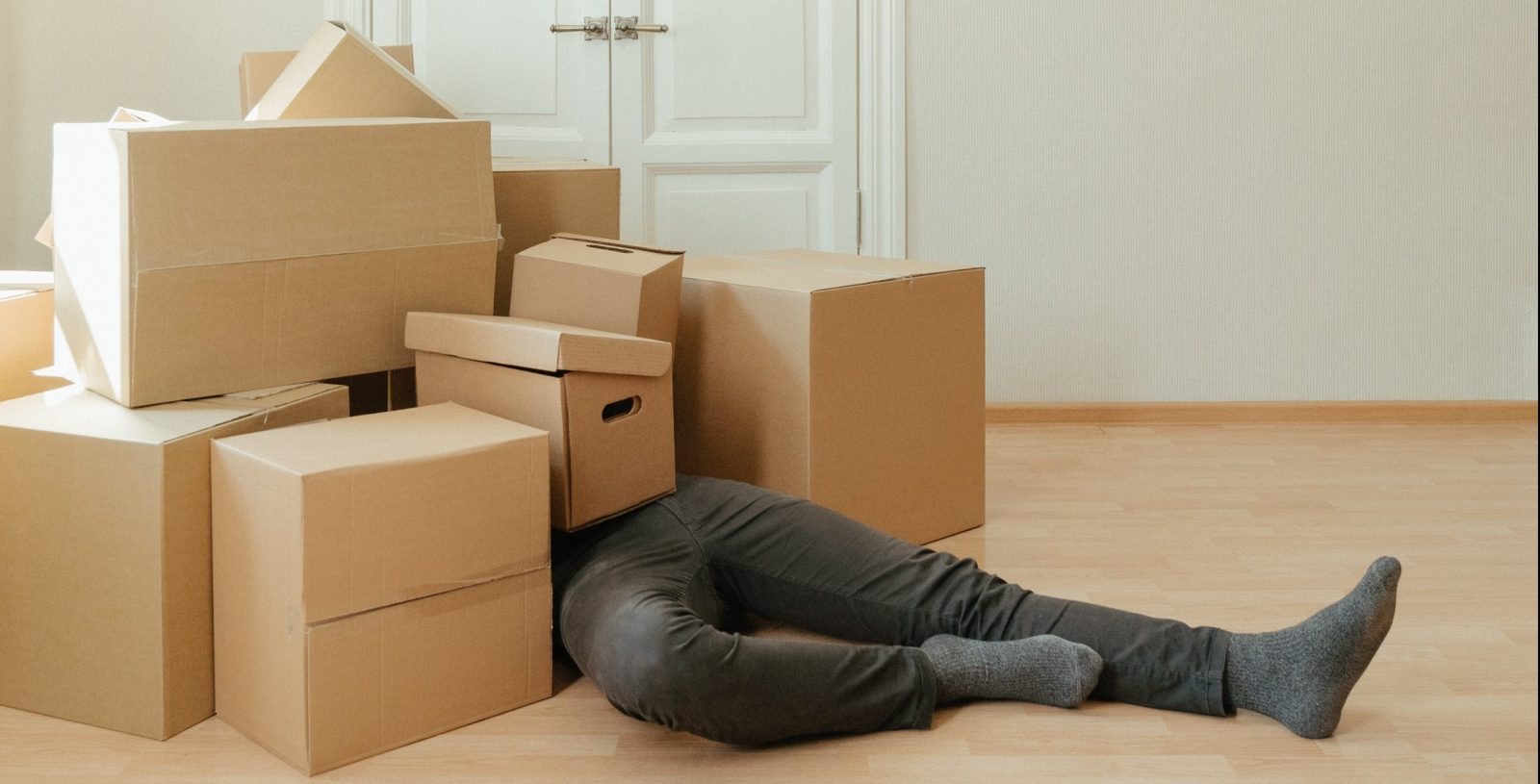 A person buried under a pile of boxes