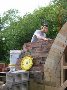 nate working on the chimney on the gustin kiln 2006