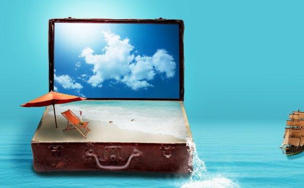 Image montrant un clavier d'ordinateur remplacé par une valise pleine d'eau de mer + plage