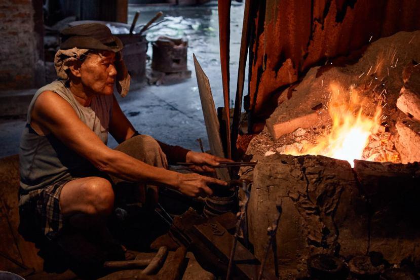 Artisan making stone polished bronzeware in Ban Bu Bangkok Thailand