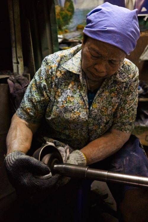 Bronzeware polishing at Ban Bu Bangkok Thailand.