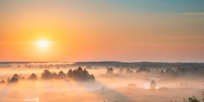 Sun rising over the clouds