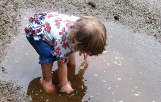child in a puddle