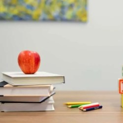apple on teachers desk and abc