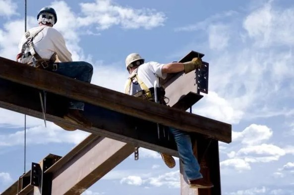 Construction workers and steel beams