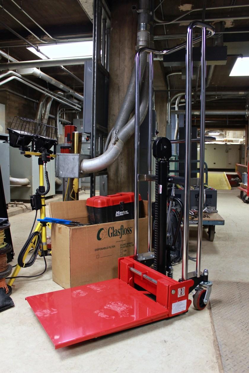 temporarily remove UPS batteries - Platform Lift Truck