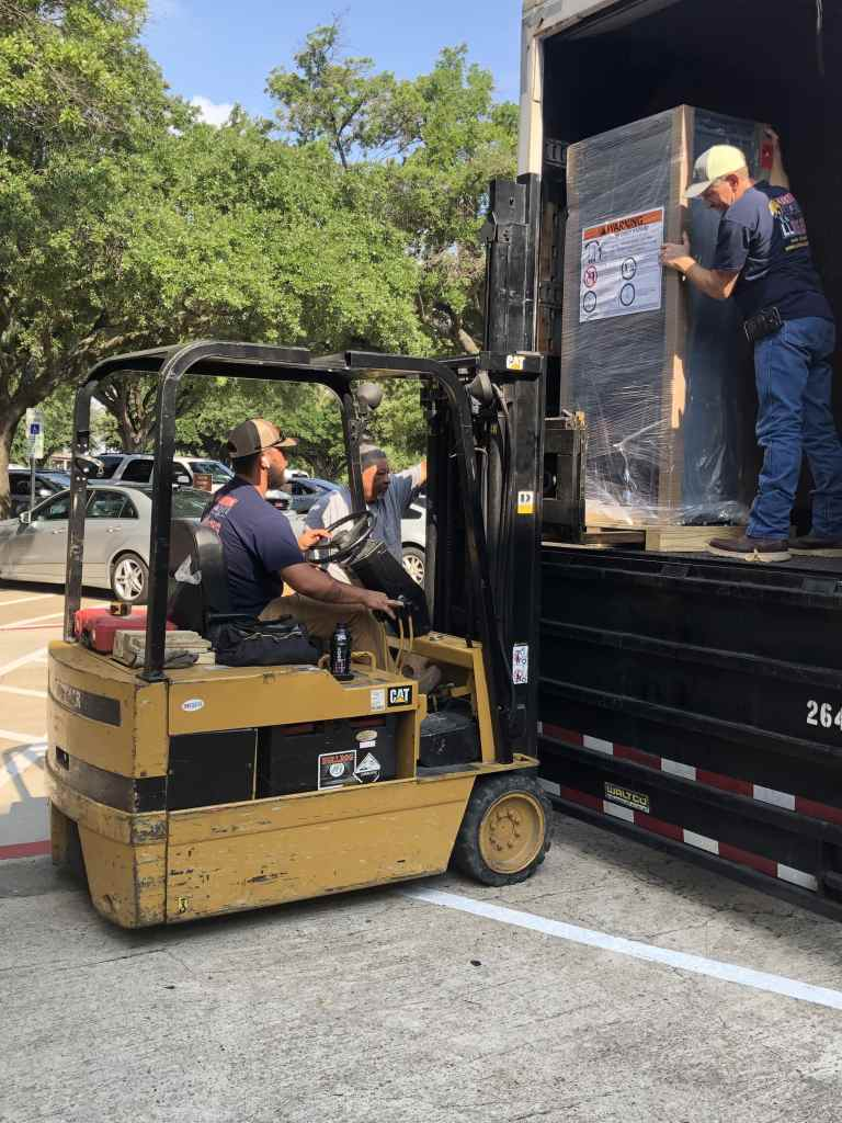 Off-loading UPS System with forklift and installation