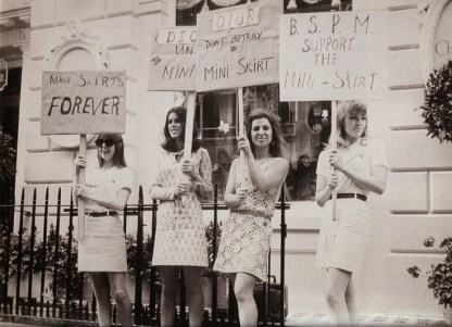 Girls from the British Society for the Protection of Mini Skirts stage a protest outside the House of Dior, for its 'unfair' treatment of mini skirts, ca. 1966.